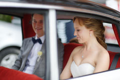 Bride and groom in a wedding car Royalty Free Stock Photo