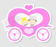 Bride and groom in a wedding carriage Stock Photos