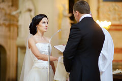 Bride and groom during a wedding ceremony Stock Photos