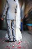 Bride and groom at wedding ceremony hand in hand Stock Images