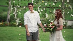 Bride and groom at wedding ceremony. Tropical garden at the evening. Lovely newlyweds couple.  stock footage