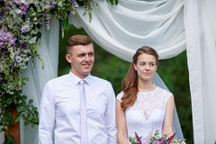 Bride and groom at a wedding ceremony under the arch Royalty Free Stock Images