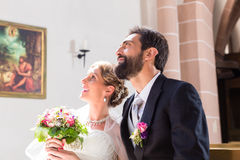 Bride and groom at wedding in church Royalty Free Stock Photography