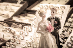 Bride and groom wedding couple figurine with rings Royalty Free Stock Photos