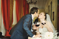 Bride and groom wedding couple together in cafe Royalty Free Stock Photos