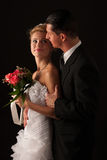 Bride and groom on wedding day isolated. Over black background Stock Photography