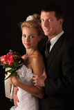 Bride and groom on wedding day isolated. Over black background Stock Image
