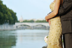 Bride and groom in wedding day in Rome near Tevere river Stock Images