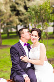 Bride and Groom at wedding Day walking Outdoors on Royalty Free Stock Images