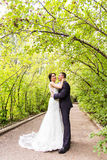 Bride and Groom at wedding Day walking Outdoors on Royalty Free Stock Photography