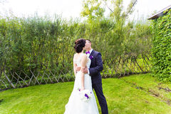 Bride and Groom at wedding Day walking Outdoors on Royalty Free Stock Image