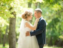 Bride and Groom at wedding Day walking Outdoors on spring nature royalty free stock photography