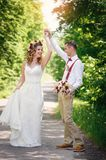 Bride and Groom at wedding Day walking Outdoors Royalty Free Stock Photography