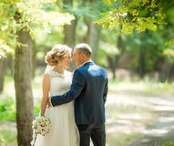 Bride and Groom at wedding Day walking Outdoors on spring nature stock photography