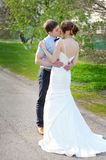 Bride and Groom at wedding Day walking on spring nature Royalty Free Stock Photography