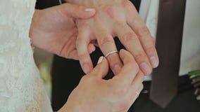 Bride and groom at wedding exchange rings stock video