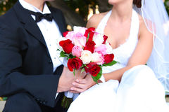Bride and Groom with Wedding Flowers Stock Photography