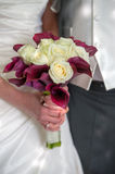 Bride and groom with wedding flowers Royalty Free Stock Image