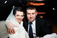 Bride and groom in wedding limo Stock Images