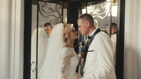 Bride and groom wedding before mirror door stock video
