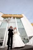 Bride and groom with wedding pigeons Stock Photo