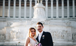 Bride and groom wedding poses in front of Altar of the Fatherland (Altare della Patria), Rome, Italy stock images