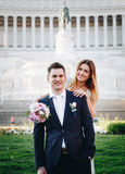 Bride and groom wedding poses in front of Altar of the Fatherland (Altare della Patria), Rome, Italy stock image
