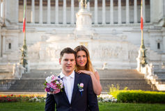 Bride and groom wedding poses in front of Altar of the Fatherland (Altare della Patria), Rome, Italy stock photography