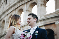 Bride and groom wedding poses in front of Colosseum, Rome, Italy Stock Photos