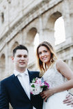 Bride and groom wedding poses in front of Colosseum, Rome, Italy Royalty Free Stock Image