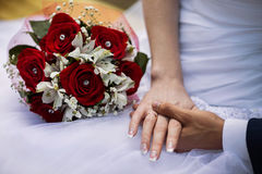 Bride and groom with wedding rings on their hands, male and female hand with wedding rings. Wedding ceremony, together forever, wedding flowers, wedding Stock Images
