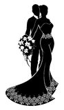 Bride and Groom Wedding Silhouette. A bride and groom wedding couple in silhouette with the bride in a bridal dress gown holding a floral bouquet of flowers and Stock Photos