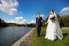 Bride and groom on wedding walk stock image