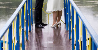 Bride and groom at wedding walk on bridge Royalty Free Stock Photography