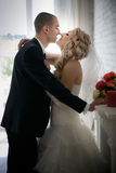bride and groom at the wedding walk in front window Royalty Free Stock Photography