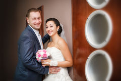 bride and groom on the wedding walk in the modern hotel hall Stock Photography