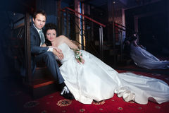 Bride and groom on the wedding walk in the modern hotel hall Royalty Free Stock Image