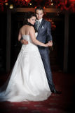 Bride and groom on the wedding walk in the modern hotel hall Royalty Free Stock Photos