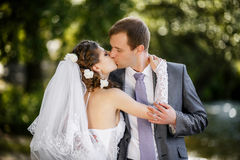 Bride and groom on the wedding walk. Bride and groom in the park Stock Photography