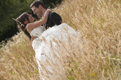 Bride and groom into a wheat field Royalty Free Stock Images