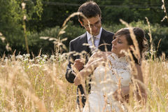 Bride and groom into a wheat field Stock Image