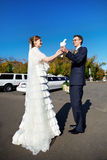 Bride and groom with white pigeons on wedding walk Royalty Free Stock Image