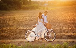 Bride and groom with a white wedding bike Stock Images