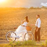 Bride and groom with a white wedding bike. Beautiful bride and groom wedding portrait with white bike Royalty Free Stock Image