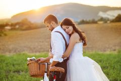 Bride and groom with a white wedding bike Royalty Free Stock Images