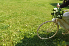 Bride and groom with a white wedding bike Stock Photos