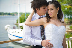 Bride and groom on white yacht background Stock Photography