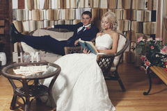 The bride and groom on the wicker furniture Stock Images