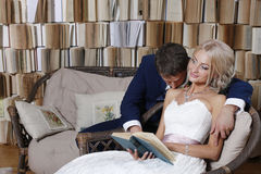 The bride and groom on the wicker furniture Royalty Free Stock Images