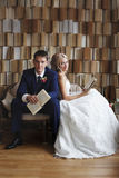 The bride and groom on the wicker furniture Stock Photography